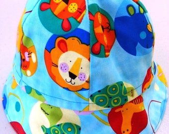 Baby boy's or girl's handmade cotton bucket hat jungle animals lion giraffe size 47cm fit 6-12 mths free Aus post.