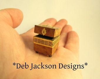 From *DJD* Tiny trinket box or casket.