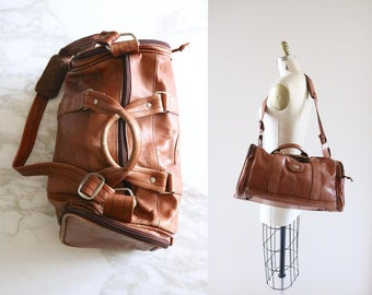 1970's rustic leather duffle bag