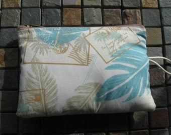 makeup jewelry bag in hawaiian aqua and brown print