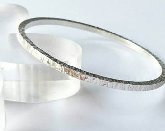 Sterling silver handmade square wire round textured bangle, hallmarked in Edinburgh.