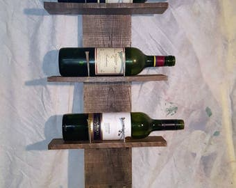 Rustic reclaimed wall mounted wood wine rack, distressed wood and nails used