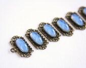 Supply: Vintage Bracelet Links Set Ornate Decorative Brass Settings Oval Faux Star Gems Light Blue Periwinkle Glass Cabochons 1930s 1940s