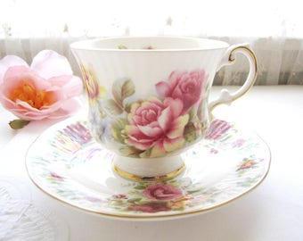 Vintage Bone China Tea Cup and Saucer Elizabethan Bone China Tea Set Cup and Saucer Hand Painted Roses Made in England from AllieEtCie