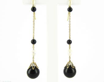 Art Deco Onyx & Opal Drop Earrings. Long Onyx, Opal and Rock Crystal 18 Carat Yellow Gold Dangle Earrings, Circa 1920s.