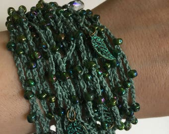 Crocheted beaded multistrand bracelet with charms and crystals