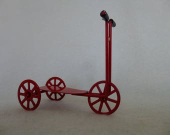Miniature Red Scooter