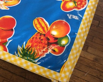 Rectangle Tropical Fruit Blue Oilcloth Tablecloth with Yellow Gingham Trim