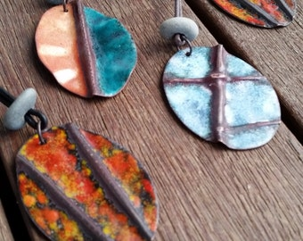 Fold formed and torch fired enamel pendants, adjustable leather cord, blue mottle, red orange mottle, teal, beach stone