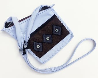 Ripped Jeans Flat Mini Bag, a Soft Blue Passport Style Bag, by Vic Von Pip