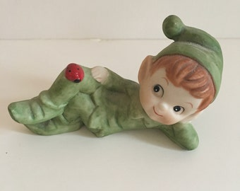 Vintage Reclining Elf Figurine with Ladybug