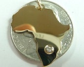 africa   20mm  tall. 18k  Solid Gold. with a diamond 1.5 pt  in any country