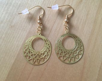 Only one! Gold filigree earrings.