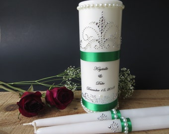 Three Piece Personalized Unity Candle set made with rhinestones and pearls and accented with a deep  green ribbon.