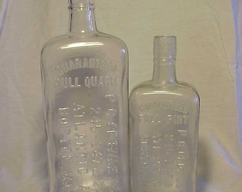 Set of Two c1890s P. C. Crowley & Co. Boston, Mass., Pint and Quart Cork Top Blown Glass Whiskey Flask Bottles