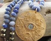 Blue knotted necklace - Blue Eyes - artisan bronze topaz guardian eye star medallion boho by slashKnots