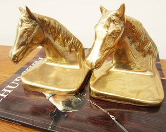 Classic Kentucky Derby decor.  Vintage pair of brass horse head bookends.