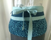 Teacher Apron/Utility Apron with 8 pockets and loop in navy and light blue floral and polka dots