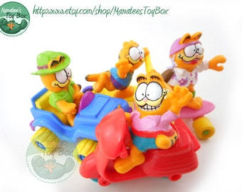 Vintage Garfield Toys 1980s Set of Four: Skateboard, Scooters, 4-Wheeler