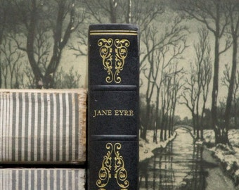 DENTED Jane Eyre book by Charlotte Bronte bound in dark blue faux leather