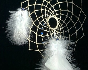 Floating weave dream catcher for artistic vision