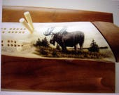 Antler cribbage board featuring a Bull Moose in scrimshaw