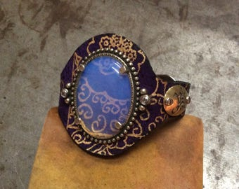 PurpLe & GoLd suede Leather bracelet Cuff with Opalite stone set in White Bronze oval frame Lined with iridescent white leather
