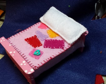 Doll bed  (doll not included )