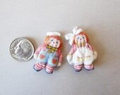 version of vintage raggedy Anne  and Andy dolls in miniature
