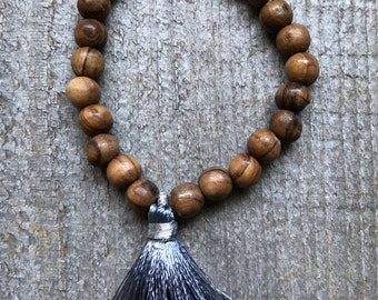 Olive wood and gray tassel stretch stacking bracelet