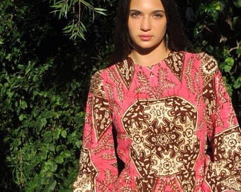 Amazing 1960's Pink and brown Ethnic Hawaiian Print Dress with gathered waist, elastic cuffs and flounce hem.