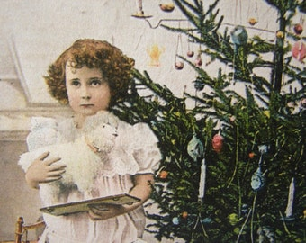French Victorian style, Joyeaux Noel, Happy Christmas,little girl with toys tinted photo image, small Holiday gift