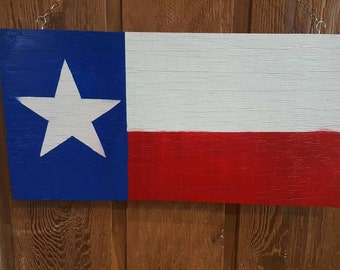 Hand painted TX flag on reclaimed wood plank