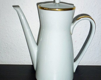 White coffee pot with gold rim