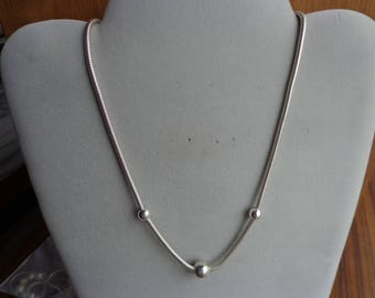 Silver (.925) chain/bead necklace.