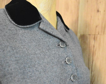 1950s Gray wool suit with black velvet collar and rhinestone buttons and pocket detail by Moordale Juniors and Davidson's Vassar Guild