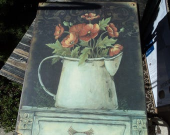 Lovely arrangement of orange poppies on a large sheet of tin