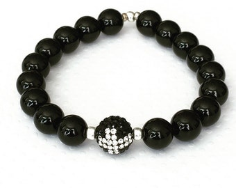 Mens bracelet. Handmade jewelry. Stretch bracelet. Cross bracelet. Rhinestone Cross. .Black beaded bracelet. Sugarplum Gallery.