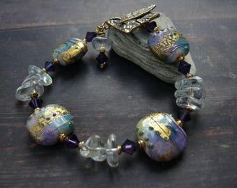 The Coronation of Gammelyn - aqua gold violet white artisan lampwork, green amethyst, swarowski crystal, brass bracelet