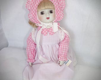 Spring Time Porcelain Doll .  Schmid Porcelain  Pink Doll .  You are my Sunshine Doll.  Musical Doll . Pink Dolls .