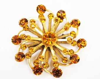 Atomic Brooch - Amber Rhinestones - gold tone setting - Mid-century  orange crystal Pin