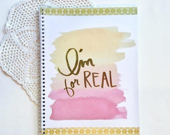 """Spiral notebook with title """"I'm For Real"""" in gold foil"""