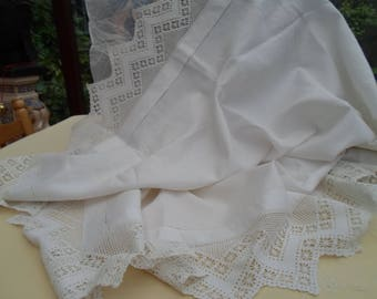 White cotton lace edged tablecloth