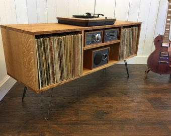 Mid century modern record player console, turntable, stereo cabinet with LP album storage. Quartersawn white oak with steel hairpin legs.