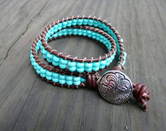 Turquoise and dark brown double leather wrap bracelet.