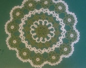 Hand tatted green and white doily