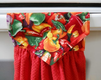 PEPPERS, Beautiful, colorful peppers on the top of a red hanging kitchen towel. Has  top that snaps over an appliance.