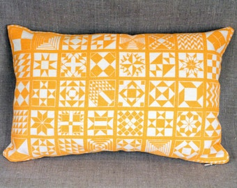 "Tangerine block printed ""Quilt Legacy"" pattern by Isabel Natti 11"" x 17"" throw pillow"