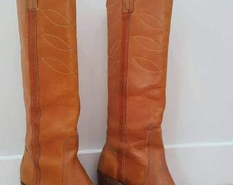 Tall brown leather Frye boots. Womens size 8 B.  Made in the USA.