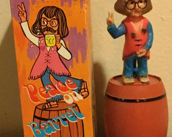 Peace on Barrel Hippie Peeing Water/Squirt Plastic Toy Hong Kong - Free USA Shipping